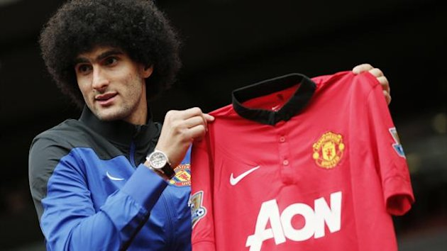 Manchester United's new signing Marouane Fellaini poses with a club shirt (Reuters)