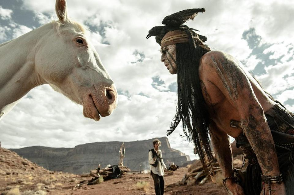 "This publicity image released by Disney shows Johnny Depp as Tonto, right, and Armie Hammer as The Lone Ranger, in a scene from ""The Lone Ranger,"" opening July 3, 2013. (AP Photo/Disney Enterprises, Inc. and Jerry Bruckheimer Inc., Peter Mountain)"