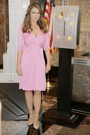 Elizabeth Hurley visits the Empire State Building in celebration of the 20th Anniversary of the Estee Lauder Companies' Breast Cancer Awareness Campaign on October 1, 2012 in New York City -- Getty Images
