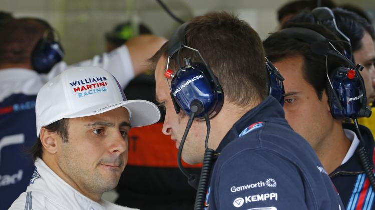 Williams Formula One driver Massa talks with engineers during a practice session at the Belgian F1 Grand Prix in Spa-Francorchamps