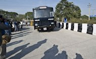 An Indian prisoner transport vehicle arrives at the district court in New Delhi on January 21, 2013. Five men have gone on trial over the fatal gang-rape of student on a bus in Delhi as the victim's father urged the special fast-track court to deliver swift justice and sentence her attackers to hang
