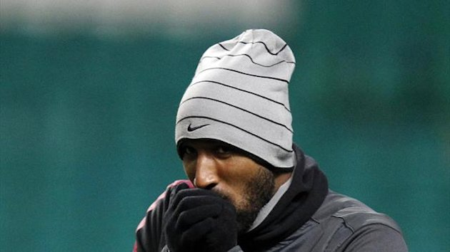 Nicolas Anelka blows into his hands during a training session for Juventus (Reuters)