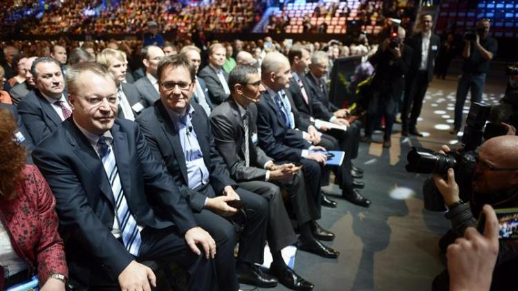 Nokia Leadership team members, Elop and Halbherr, attend the company's EGM in Helsinki