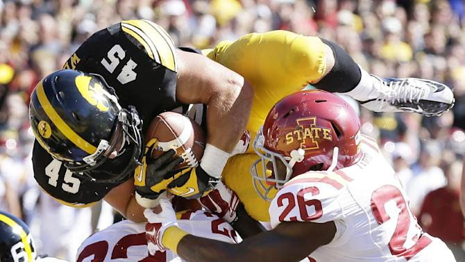 Iowa searching for answers on offense