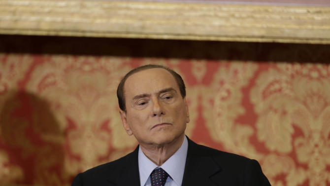 Former Italian Premier Silvio Berlusconi ponders a question during a press conference in Gerno, near Milan, Saturday, Oct. 27, 2012. Silvio Berlusconi, who announced this week he wouldn't run in spring elections, pulled an about-face Saturday and said he felt compelled to stay in politics to reform Italy's justice system after being convicted of tax fraud. (AP Photo/Luca Bruno)
