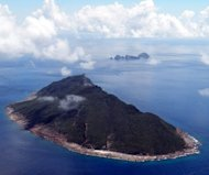 This file photo shows the disputed islands, known as Senkaku in Japan and Diaoyu in China, in the East China Sea, pictured on September 15, 2010. Japanese Prime Minister Shinzo Abe has demanded Beijing apologise and admit that a Chinese frigate got a radar lock on a Japanese destroyer in international waters, according to reports in the Japanese media