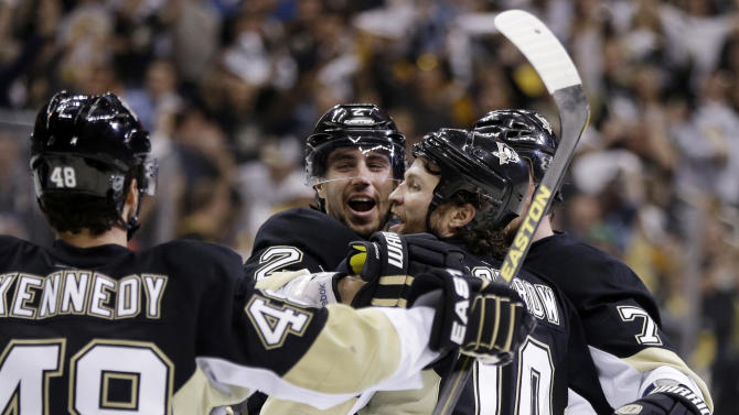 Pittsburgh Penguins' Brenden Morrow (10) celebrates with Matt Niskanen, second from left, after scoring in the second period of Game 2 of an NHL hockey Stanley Cup second-round playoff series against the Ottawa Senators, in Pittsburgh on Friday, May 17, 2013. (AP Photo/Gene J. Puskar)