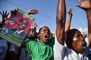 Demonstrators shout during a protest near the parliament…