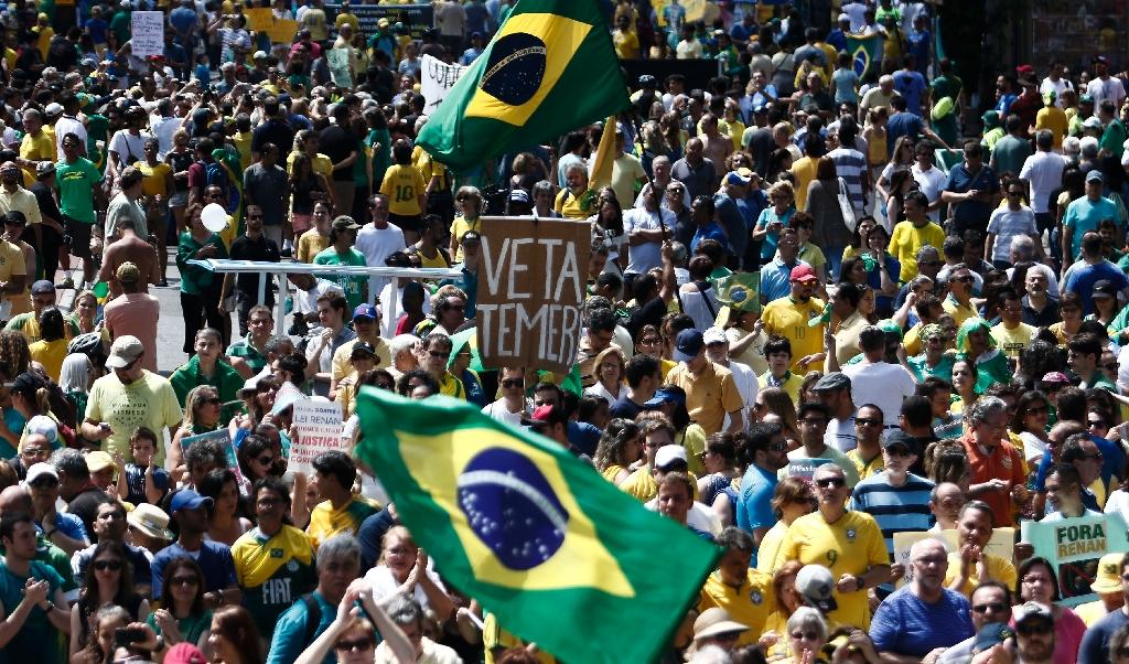Brazilians protest corruption, target president's ally