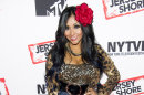 """FILE - In this Oct. 24, 2012 file photo, Jersey Shore cast member Nicole """"Snooki"""" Polizzi attends a panel entitled """"Love, Loss, (Gym, Tan) and Laundry: A Farewell to the Jersey Shore,"""" in New York. MTV says """"Jersey Shore"""" stars Nicole """"Snooki"""" Polizzi and Jenni """"JWOWW"""" Farley and comedian Jeff Dye will host the network's live New Year's Eve special, """"MTV's Club NYE 2013,"""" from Times Square. (Photo by Charles Sykes/Invision/AP, File)"""