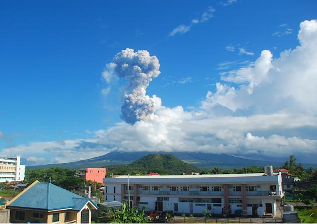 A cloud of volcanic ash shoots up to the sky as Mayon volcano, one of the Philippines' most active volcanoes, erupts after daybreak, viewed from Legazpi city in Albay province in the central Philippin