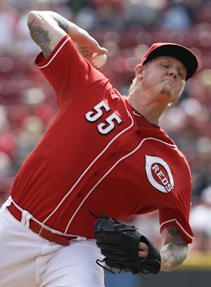 Reds' Latos out for wild card game with sore elbow