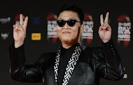 K-pop sensation Psy Oppa showing a peace sign