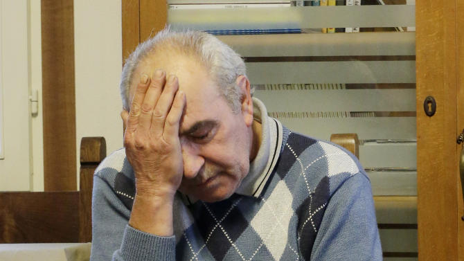 In this Nov. 22, 2012 photo, Amedeo Tartarini puts his head in his hand during an interview in Nove, near Vicenza, Italy. Tartarini's goldsmith business thrived for decades in Italy's postwar boom, but the country's financial crisis and cheap competition from China brought it to an end. In many rich countries, a person like Tartarini, who has lost his home, his business and his life's savings, might have ended up on the street. Instead, he has managed to keep afloat thanks to friends and community spirit. (AP Photo/Antonio Calanni)