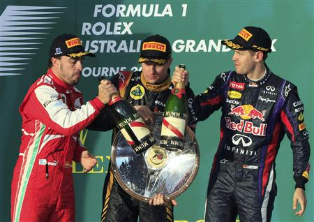 Ferrari Formula One driver Alonso of Spain, Lotus Formula One driver Raikkonen of Finland and Red Bull Formula One driver Vettel of Germany celebrate after the Australian F1 Grand Prix in Melbourne