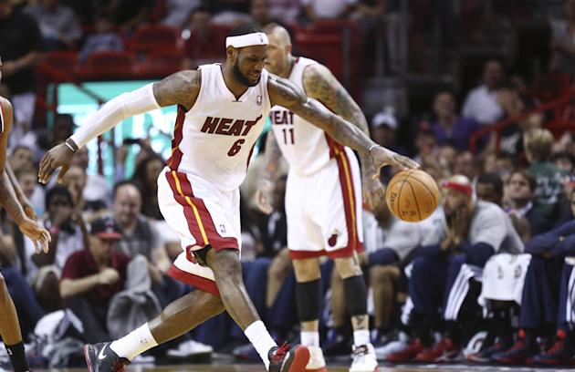Miami Heat's LeBron James grabs a ball during the second half of an NBA basketball game in Miami, Monday, March 10, 2014 against the Washington Wizards. The Heat won 99-90. (AP Photo/J Pat Carter)