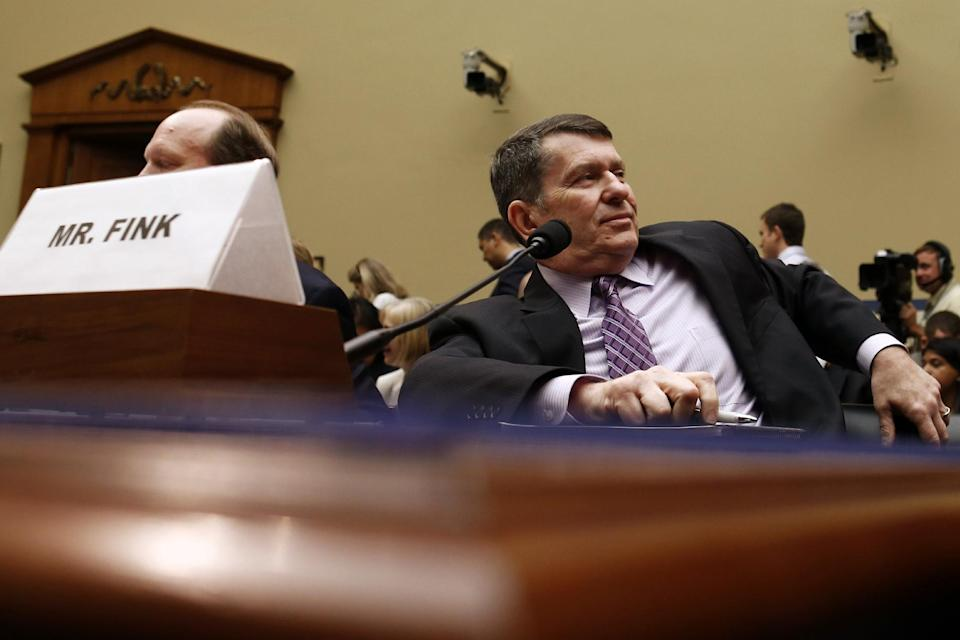 Faris Fink, Commissioner, Small Business and Self-Employed Division, Internal Revenue Service, is seated at the witness table on Capitol Hill in Washington, Thursday, June 6, 2013, during a break in House Oversight and Government Reform Committee hearing regarding IRS conference spending. (AP Photo/Charles Dharapak)