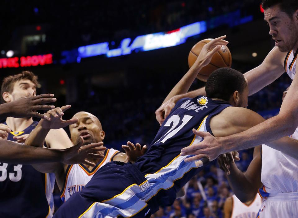 Oklahoma City Thunder forward Nick Collison, right, fouls Memphis Grizzlies forward Tayshaun Prince (21) in the second quarter of Game 1 of their Western Conference Semifinals NBA basketball playoff series in Oklahoma City, Sunday, May 5, 2013. (AP Photo/Sue Ogrocki)