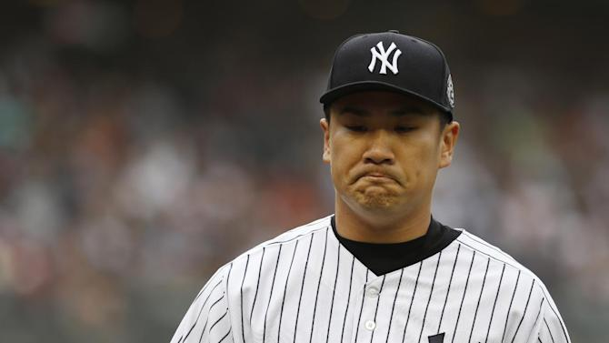 New York Yankees starting pitcher Masahiro Tanaka reacts during the first inning of the baseball game against the Toronto Blue Jays at Yankee Stadium, Sunday, Sept. 21, 2014 in New York. (AP Photo/Seth Wenig)