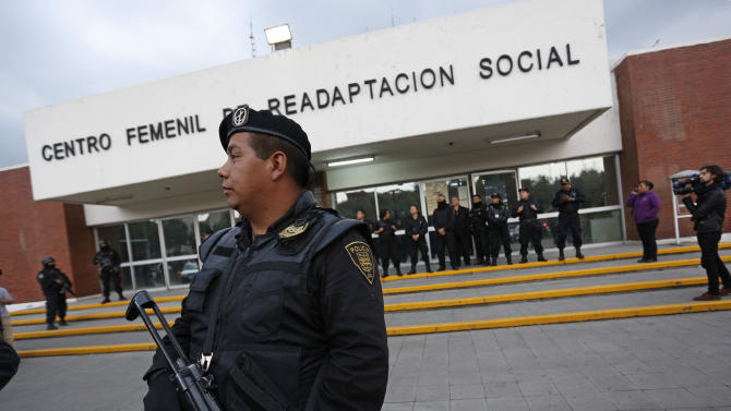 "A police officer stands guard outside a prison where Frenchwoman Florence Cassez had been held in Mexico City, Wednesday, Jan. 23, 2013. A Mexican Supreme Court panel voted Wednesday to release Cassez, a Frenchwoman who says she was unjustly sentenced to 60 years in prison for kidnapping and whose case became a cause celebre in France, straining relations between the two countries. A police convoy with sirens flashing escorted a white sports utility vehicle out of the prison where Cassez had been held later Wednesday, presumably carrying her to the Mexico City airport. Relatives of kidnap victims angrily shouted ""Killer!"" as the vehicle pulled away. (AP Photo/Andres Leighton)"