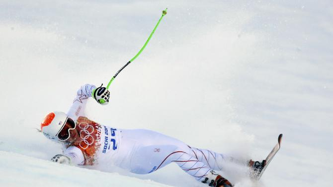 Cook of the U.S. crashes during the women's alpine skiing Super G competition at the 2014 Sochi Winter Olympics