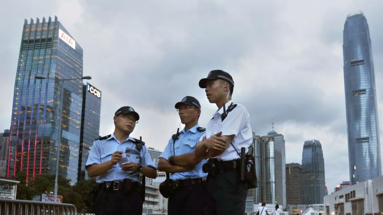 Police officers are seen in the central financial district of Hong Kong
