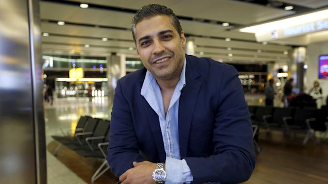 Canadian journalist Mohamed Fahmy, who was recently freed from jail in Egypt, is pictured after arriving on a flight from Cairo, at London's Heathrow airport, Britain