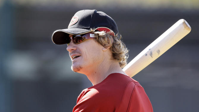 FILE - In this Feb. 18, 2009, file photo, Arizona Diamondbacks' Eric Byrnes gets ready to bat during spring training baseball in Tucson, Ariz. On Tuesday, July 28, 2015, a computer will stand in to call balls and strikes in what is considered to be the first professional game without an umpire calling the pitches. (AP Photo/Elaine Thompson, File)