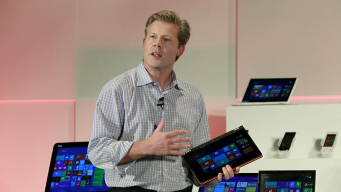 Microsoft Corporation's Corporate Vice President Nick Parker describes new products during the Computex Taipei 2013, one of the world's largest IT exhibitions, in Taipei, Taiwan, Wednesday, June 5, 2013. During Wednesday's event, Microsoft unveiled its operating system upgrade 8.1. (AP Photo/Wally Santana)