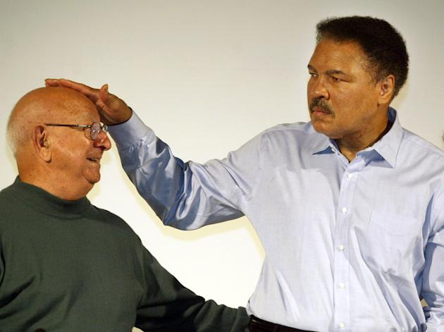 FILE - In this Oct. 9, 2003 file photo,  boxing legend Muhammad Ali touches the head of his former coach Angelo Dundee at the Book Fair in Frankfurt, Germany. The three-time heavyweight boxing champio