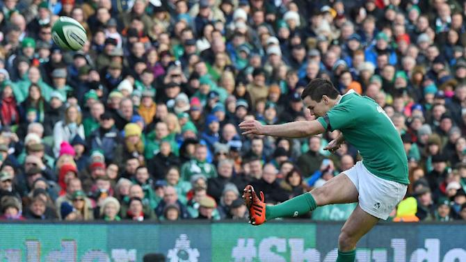 Ireland's Johnny Sexton kicks their second penalty during the Six Nations match against England at Aviva Stadium on March 1, 2015