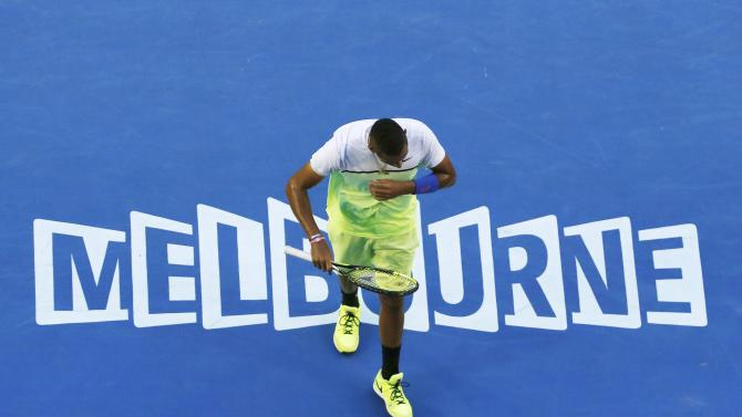 Nick Kyrgios of Australia reacts after missing a return against Andy Murray of Britain during their men's singles quarter-final match at the Australian Open 2015 tennis tournament in Melbourne