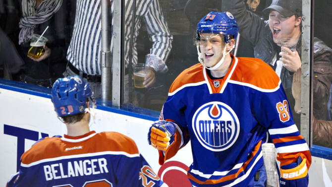 Edmonton Oilers' Eric Belanger, left, and Ales Hemsky, celebrate Hemsky's goal against the Colorado Avalanche during the second period of an NHL hockey game in Edmonton, Alberta, Saturday, Feb. 16, 2013. (AP Photo/The Canadian Press, Jason Franson)