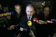 <p>Outgoing UMP general secretary Jean-Francois Cope speaks to the press surrounded by supporters on November 25, in Paris. Ex-president Nicolas Sarkozy on Monday waded in to a bitter leadership battle that has left France's main right-wing opposition party, the UMP, on the verge of collapse.</p>