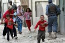 Children run away after an explosion in Kabul