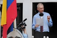 Wikileaks founder Julian Assange addresses the media and his supporters from the balcony of the Ecuadorian Embassy in London on August 19. Ecuadoran President Rafael Correa says he believes his country had overcome a diplomatic spat with Britain over its threat to enter the Ecuadoran Embassy in London in order to arrest Assange
