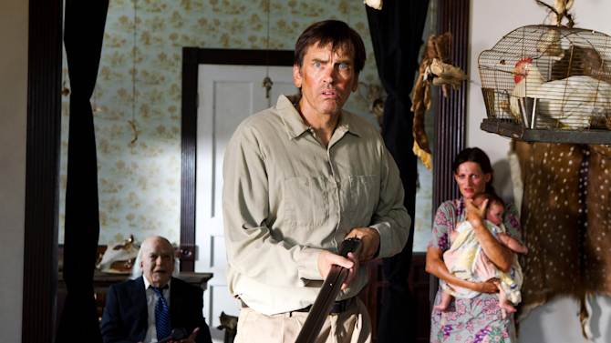 """This undated publicity film image from Lionsgate shows John Dugan, left, as Grandpa Sawyer, and Bill Moseley, center, as Drayton Sawyer, in a scene from """"Texas Chainsaw 3-D,"""" releasing in theaters on Friday, January 4, 2013.  (AP Photo/Lionsgate, Justin Lubin)"""