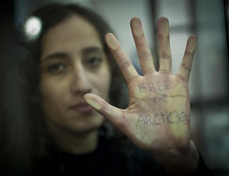 Greenpeace International activist Faiza Oulahsen of the Netherlands displays a message on her palm during a bail hearing at the Murmansk Regional Court, in this Greenpeace handout picture on October 18, 2013. REUTERS/Dmitri Sharomov/Greenpeace/Handout via Reuters