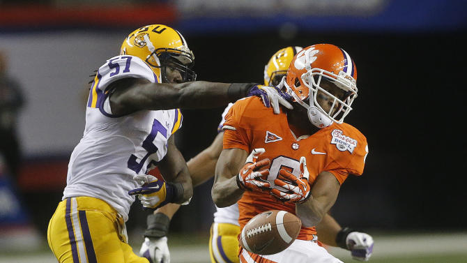 Clemson wide receiver DeAndre Hopkins (6) misses catch under pressure from LSU linebacker Lamin Barrow (57) during the second half of the Chick-fil-A Bowl NCAA college football game, Monday, Dec. 31, 2012, in Atlanta. (AP Photo/John Bazemore)