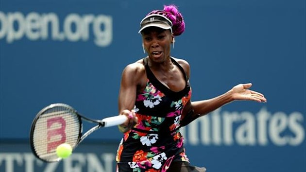 Venus Williams of the US plays a forehand during her women's first round match against Kirsten Flipkens of Belgium at the US Open (AFP)