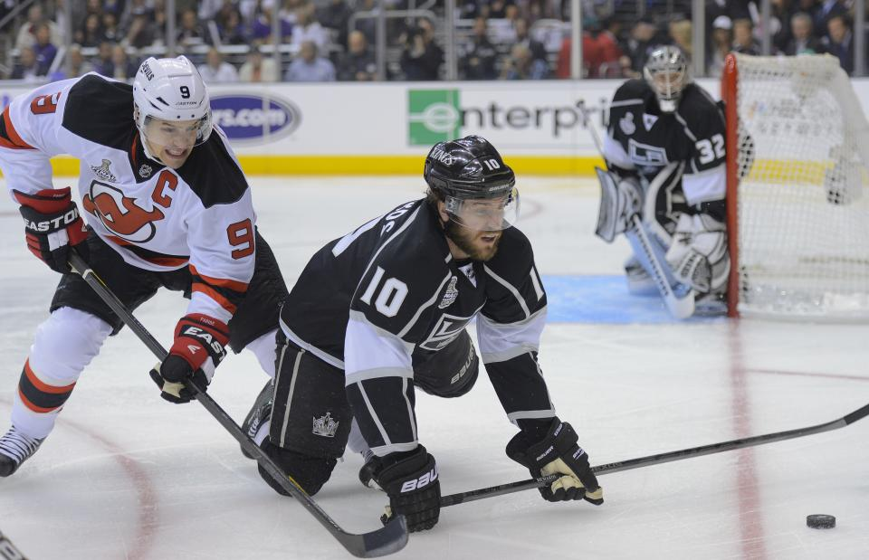 New Jersey Devils left wing Zach Parise (9) fights Los Angeles Kings center Mike Richards (10) for the puck in the first period during Game 3 of the Stanley Cup Finals, Monday, June 4, 2012, in Los Angeles.  (AP Photo/Mark J. Terrill)