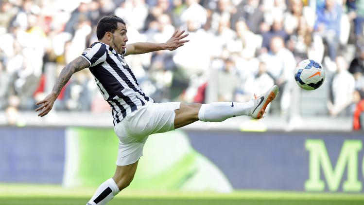 Juventus' Carlos Tevez controls the ball during their Italian Serie A soccer match against Fiorentina in Turin