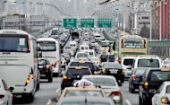 Heavy traffic head toward downtown Shanghai in 2010. The US consulate in Shanghai has begun issuing its own pollution statistics, giving a much more pessimistic assessment of the city's air quality than official Chinese data