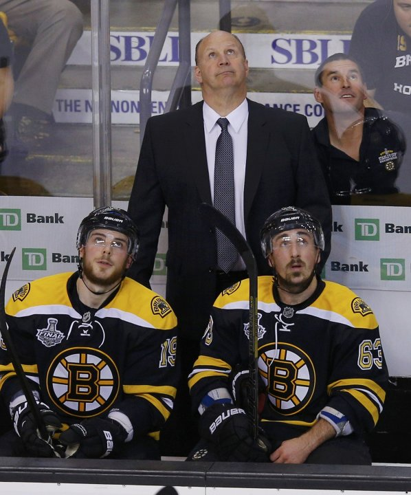 Bruins head coach Julien watches a replay with players Seguin and Marchand during the first period against the Blackhawks in Game 4 of their NHL Stanley Cup Finals hockey series in Boston