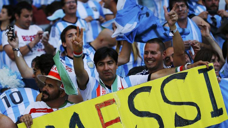 Fans of Argentina celebrate their victory in their 2014 World Cup Group F soccer match against Iran at the Mineirao stadium in Belo Horizonte