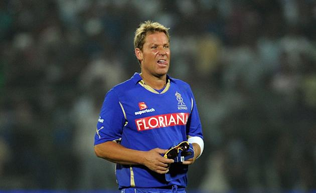 RESTRICTED TO EDITORIAL USE. MOBILE USE WITHIN NEWS PACKAGE   (FILES) In this photograph taken on April 15, 2011, Rajasthan Royals captain Shane Warne reacts after defeat of the IPL Twenty20 match bet