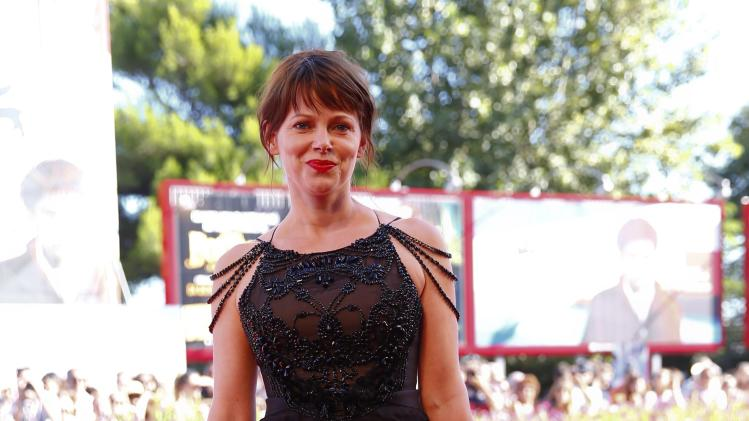 """Actress Barbora Bobulova poses during the red carpet for the movie """"Anime Nere"""" (Black Souls) at the 71st Venice Film Festival"""