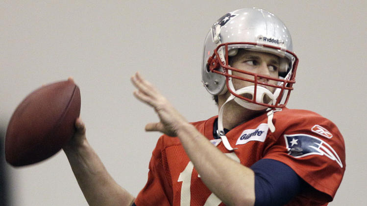 New England Patriots quarterback Tom Brady throws during NFL football practice in Foxborough, Mass., Friday, Jan. 27, 2012. The Patriots face the New York Giants in  Super Bowl XLVI on Feb. 5 in Indianapolis. (AP Photo/Elise Amendola)