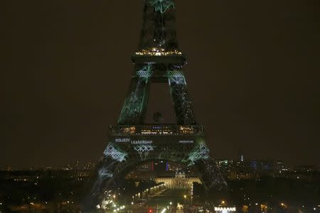 The Eiffel Tower is lit with green lights as part of the events in the French capital to mark the World Climate Change Conference 2015 (COP21), in Paris
