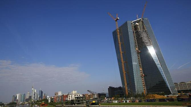 Sun glints off facade of new headquarters of ECB which is under construction in Frankfurt